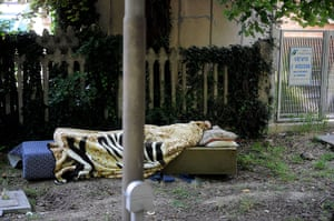 Italy earthquake: A man sleeps in a park in Crevalcore