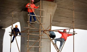 Construction workers dismantle scaffolding from a bridge construction site in Shanghai, China