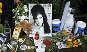 Tributes left for Amy Winehouse outside her Camden Square house, which has been put up for sale