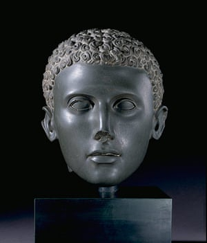 Sculpture: Head from a green siltstone statue of a young man with curly hair 100-75BC