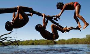 Yawalapiti children play over the Xingu River in the Xingu National Park