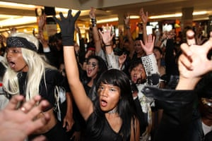 Week in music: Lady Gaga supporters perform one of her dance routines at a shopping centre
