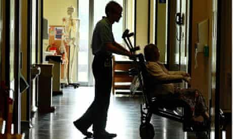 Porter pushing patient, Hinchingbrooke hospital