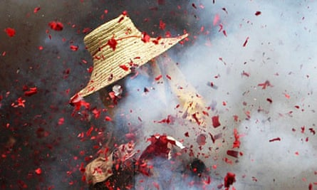A Chinese man burns fireworks during the Dragon Boat Festival