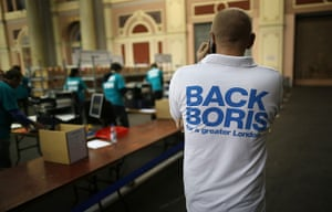 Local elections: A Boris Johnson supporter talks on the phone at an election vote