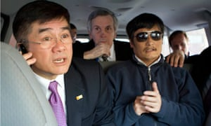 Chen Guangcheng, right, with US officials in Beijing this week
