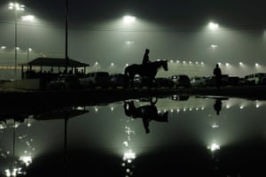 Kentucky Derby:  An exercise rider walks a horse off the track after a morning workout