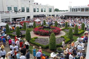 Kentucky Derby: The racing fans gather in the paddock area next to a statue of Aristide
