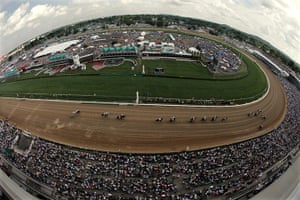 Kentucky Derby: Jockeys and their horses make their way past the grand stand
