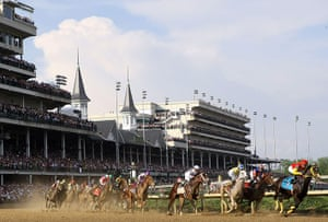 Kentucky Derby: Dullahan ridden by Kent Desormeaux leads the field around the first turn