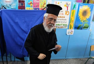European elections: A Greek Orthodox priest holds his ballot paper