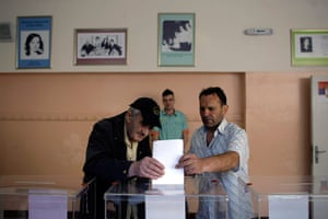 European elections: A man is being helped to cast a ballot during the elections in Belgrade