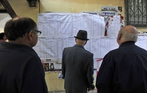 European elections: People check voting lists outside a polling station in Thessaloniki
