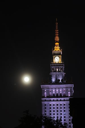 Supermoon: The moon next to the Palace of Culture and Science in Warsaw, Poland