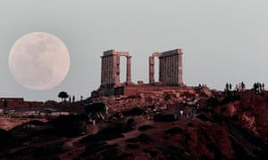Supermoon: The full moon rises behind the Temple of Poseidon in Athens, Greece