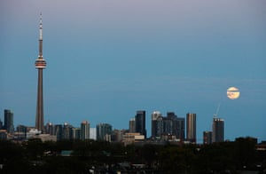 """Supermoon: The """"super Moon"""" rises over the skyline in Toronto"""