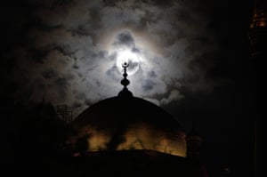 Supermoon: A full moon is seen behind the minaret of Mohamed Ali mosque, Cairo