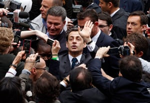 Elections: Nicolas Sarkozy waves to supporters at a voting station in Paris