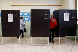 Elections: A woman and a man hold their ballots at a polling station in Cvitavecchia