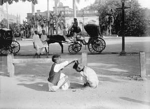 British Raj photographs: A hairdresser gives a Hindustani cut on Strand Road Kolkata
