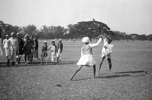 British Raj photographs: Two men stick dance, with an onlooking crowd, in Maidan, Kolkata
