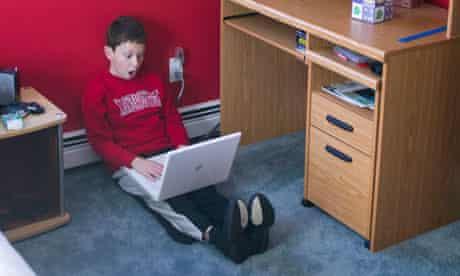 Boy on internet in bedroom