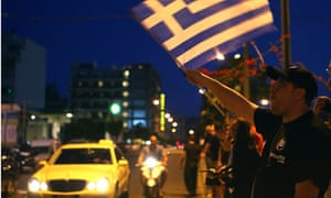 Golden Dawn supporters celebrate after early election results in Athens