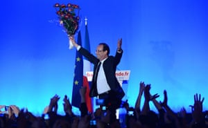 Francois Hollande wins: rancois Hollande holds a bunch of roses after speech after the results
