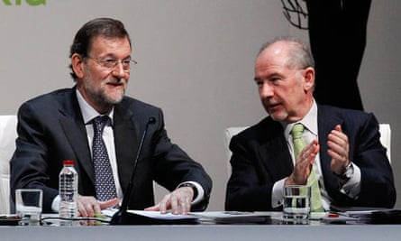 Spanish PM Rajoy and President of Spanish bank Bankia Rato after a conference in Madrid