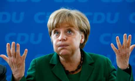 Angela Merkel reacts before a party board meeting in Berlin