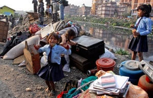 Katmandu eviction: A young Nepalese girl with her belongings