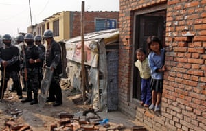 Kathmandu eviction: young Nepalese children look at a bulldozer