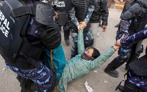 Katmandu eviction: Nepalese riot police detain a squatter