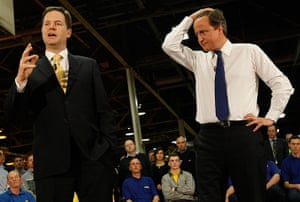 Picture desk live: David Cameron listens to Nick Clegg during a visit to CNH Tractors
