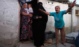 A woman complains about living conditions at her home in a shantytown in Algeria