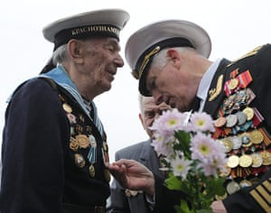 Victory Day in Russia: A Russian Navy WWII veteran examines the medals of navy sailor