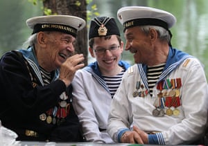 Victory Day in Russia: Russian WWII veterans and a young boy dressed in a vintage military uniform
