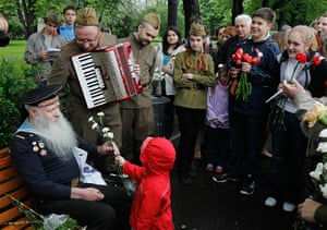Victory Day in Russia: WWII veteran Fyodor Bortsov, 86, is offered a bunch of flowers
