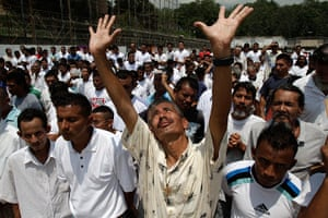 Longer View: Prison inmates pray in the courtyard