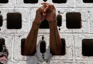 Longer View: A prisoner rests his arms in the wall of his cell