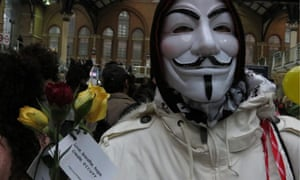 Occupy London celebrate May Day by handing out flowers in Liverpool St
