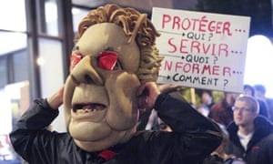 A protester dressed as Jean Charest, the Quebec premier