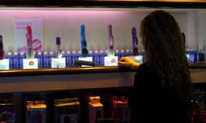 A customer inspects a selection of vibrators