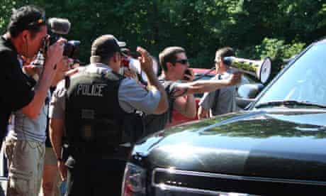 Bilderberg protestors with bullhorn