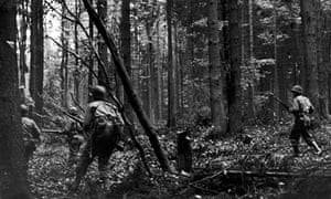 US troops march through Hurtgen Forest, Germany, 1944