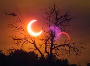 Wildfires in the US: A helicopter flies past the solar eclipse near Payson