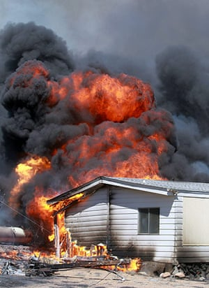 Wildfires in the US: A home is engulfed by flames from a wildfire, south of Gardnerville, Nevada
