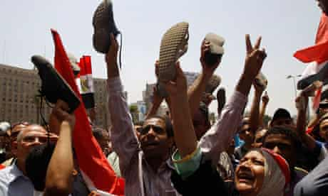 Protesters shout slogans during Friday prayers at Tahrir Square in Cairo