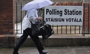 A voter arrives at a polling station to cast her ballot in Ireland's referendum