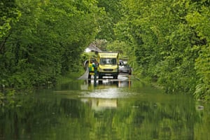 Wales floods: An emergency vehicle stops at a flooded road in Machynlleth